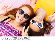 Купить «teenage girls in sunglasses showing peace sign», фото № 29278062, снято 19 июля 2018 г. (c) Syda Productions / Фотобанк Лори