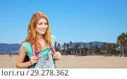 Купить «smiling woman with backpack over venice beach», фото № 29278362, снято 25 июля 2015 г. (c) Syda Productions / Фотобанк Лори