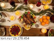 Купить «roast chicken or turkey on christmas table», фото № 29278454, снято 17 декабря 2017 г. (c) Syda Productions / Фотобанк Лори