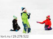 Купить «happy little kids playing outdoors in winter», фото № 29278522, снято 10 февраля 2018 г. (c) Syda Productions / Фотобанк Лори