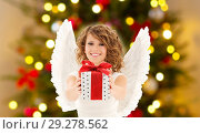 Купить «teenage girl with angel wings and christmas gift», фото № 29278562, снято 1 августа 2009 г. (c) Syda Productions / Фотобанк Лори