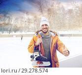 Купить «happy young man showing thumbs up on skating rink», фото № 29278574, снято 26 ноября 2014 г. (c) Syda Productions / Фотобанк Лори