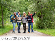 friends or travelers hiking with backpacks and map. Стоковое фото, фотограф Syda Productions / Фотобанк Лори