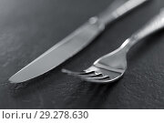 Купить «close up of fork and knife on table», фото № 29278630, снято 4 апреля 2018 г. (c) Syda Productions / Фотобанк Лори