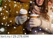 Купить «close up of happy couple with coffee at christmas», фото № 29278694, снято 2 декабря 2016 г. (c) Syda Productions / Фотобанк Лори