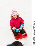 Купить «happy little girl on sled outdoors in winter», фото № 29279570, снято 10 февраля 2018 г. (c) Syda Productions / Фотобанк Лори