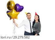 Купить «happy couple with party caps and balloons», фото № 29279582, снято 3 марта 2018 г. (c) Syda Productions / Фотобанк Лори