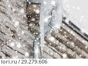 Купить «icicles hanging from building drainpipe», фото № 29279606, снято 11 ноября 2016 г. (c) Syda Productions / Фотобанк Лори