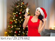 Купить «beautiful woman with champagne over christmas tree», фото № 29279662, снято 25 сентября 2015 г. (c) Syda Productions / Фотобанк Лори