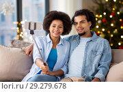 Купить «couple with smartphone taking selfie on christmas», фото № 29279678, снято 17 декабря 2016 г. (c) Syda Productions / Фотобанк Лори