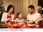 Купить «happy family having christmas dinner at home», фото № 29279762, снято 11 января 2018 г. (c) Syda Productions / Фотобанк Лори