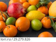 Купить «close up of citrus fruits», фото № 29279826, снято 4 апреля 2018 г. (c) Syda Productions / Фотобанк Лори