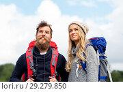 Купить «couple of travelers with backpacks hiking», фото № 29279850, снято 31 августа 2014 г. (c) Syda Productions / Фотобанк Лори