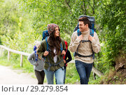 happy friends or travelers hiking with backpacks. Стоковое фото, фотограф Syda Productions / Фотобанк Лори