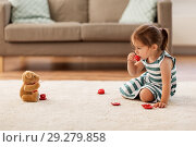 Купить «little girl playing with toy tea set at home», фото № 29279858, снято 23 июля 2018 г. (c) Syda Productions / Фотобанк Лори