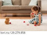 Купить «little girl playing with toy tea set at home», фото № 29279858, снято 23 июля 2018 г. (c) Syda Productions / Фотобанк Лори