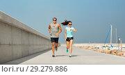 Купить «couple in sports clothes running outdoors», фото № 29279886, снято 1 августа 2018 г. (c) Syda Productions / Фотобанк Лори