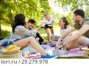 Купить «friends with drinks and food at picnic in park», фото № 29279978, снято 17 июня 2018 г. (c) Syda Productions / Фотобанк Лори