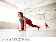 Купить «woman making high lunge exercise at yoga studio», фото № 29279986, снято 21 июня 2018 г. (c) Syda Productions / Фотобанк Лори