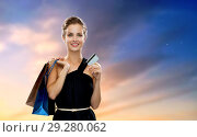 Купить «woman with credit card and shopping bags», фото № 29280062, снято 1 июня 2014 г. (c) Syda Productions / Фотобанк Лори