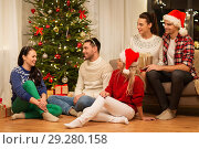 Купить «friends celebrating christmas at home», фото № 29280158, снято 17 декабря 2017 г. (c) Syda Productions / Фотобанк Лори