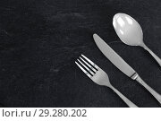 Купить «close up of fork, knife and spoon on table», фото № 29280202, снято 4 апреля 2018 г. (c) Syda Productions / Фотобанк Лори