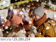 Купить «happy couple holding hands at christmas market», фото № 29280254, снято 2 декабря 2016 г. (c) Syda Productions / Фотобанк Лори