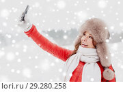 Купить «happy woman taking selfie outdoors in winter», фото № 29280258, снято 7 января 2017 г. (c) Syda Productions / Фотобанк Лори