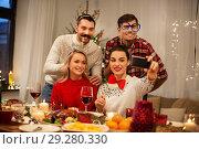 Купить «friends taking selfie at christmas dinner», фото № 29280330, снято 17 декабря 2017 г. (c) Syda Productions / Фотобанк Лори