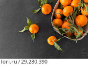 Купить «close up of mandarins on slate table top», фото № 29280390, снято 4 апреля 2018 г. (c) Syda Productions / Фотобанк Лори