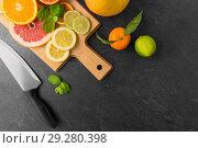 Купить «close up of fruits and knife on slate table top», фото № 29280398, снято 4 апреля 2018 г. (c) Syda Productions / Фотобанк Лори