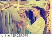 Купить «Happy young female friends choosing trousers», фото № 29289670, снято 19 января 2019 г. (c) Яков Филимонов / Фотобанк Лори