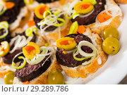 Купить «Sandwiches with blood sausage and olives», фото № 29289786, снято 17 сентября 2019 г. (c) Яков Филимонов / Фотобанк Лори