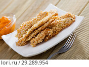 Купить «Tasty fried chicken fingers from fillet in sesame at plate on table», фото № 29289954, снято 16 января 2019 г. (c) Яков Филимонов / Фотобанк Лори