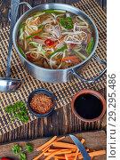 Купить «duck noodle vegetables soup in a metal casserole», фото № 29295486, снято 19 октября 2018 г. (c) Oksana Zh / Фотобанк Лори