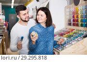 Купить «cheerful couple examining various paints in paint store», фото № 29295818, снято 9 марта 2017 г. (c) Яков Филимонов / Фотобанк Лори