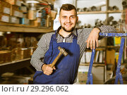 Happy male worker showing his working tools. Стоковое фото, фотограф Яков Филимонов / Фотобанк Лори