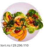 Купить «Salad of baked pumpkin, cherry tomatoes, sesame, sauce and greens», фото № 29296110, снято 16 января 2019 г. (c) Яков Филимонов / Фотобанк Лори