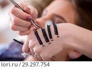 Купить «Young woman getting eyelash extension», фото № 29297754, снято 29 января 2018 г. (c) Elnur / Фотобанк Лори