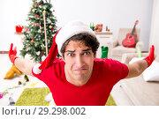 Купить «Man cleaning his apartment after christmas party», фото № 29298002, снято 17 июля 2018 г. (c) Elnur / Фотобанк Лори