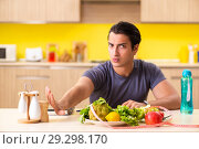 Купить «Young man in dieting and healthy eating concept», фото № 29298170, снято 19 июня 2018 г. (c) Elnur / Фотобанк Лори
