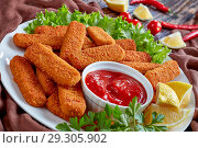 Купить «crumbed fish sticks served with ketchup», фото № 29305902, снято 22 октября 2018 г. (c) Oksana Zh / Фотобанк Лори