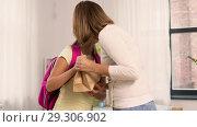 Купить «loving mother giving school lunch to daughter», видеоролик № 29306902, снято 19 октября 2018 г. (c) Syda Productions / Фотобанк Лори