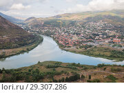 Купить «Beautiful view from Jvari Monastery to confluence of Aragvi and Kura rivers, town of Mtskheta and Svetitskhoveli Cathedral», фото № 29307286, снято 23 сентября 2018 г. (c) Юлия Бабкина / Фотобанк Лори
