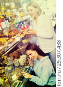 Купить «Female friends selecting fine chocolates and confectionery at ca», фото № 29307438, снято 12 декабря 2018 г. (c) Яков Филимонов / Фотобанк Лори