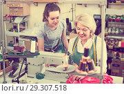 Купить «Two concentrated women tailors working with sewing machines», фото № 29307518, снято 11 декабря 2018 г. (c) Яков Филимонов / Фотобанк Лори