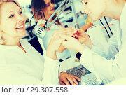 Купить «Woman having manicure in salon», фото № 29307558, снято 2 ноября 2016 г. (c) Яков Филимонов / Фотобанк Лори
