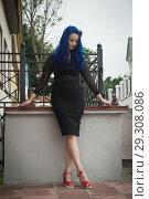 Купить «Rock girl with blue hair on a city street», фото № 29308086, снято 25 июня 2018 г. (c) Дмитрий Черевко / Фотобанк Лори