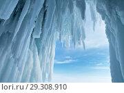 Купить «Icicles in an ice grotto in the cliffs of Olkhon Island on the Siberian lake Baikal on a cold day. Natural winter background», фото № 29308910, снято 9 марта 2013 г. (c) Виктория Катьянова / Фотобанк Лори