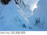 Купить «The icy rocks on the Siberian lake Baikal on a cold day. Natural winter background», фото № 29308950, снято 23 февраля 2013 г. (c) Виктория Катьянова / Фотобанк Лори